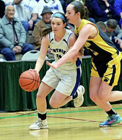 Hoosick Falls' #10 Rachel Pine, leftt, and Canton's #5 Mikaela Bessette during the Class B girls' basketball regional final at HVCC Saturday March 14, 2015 in Troy, NY.  (John Carl D'Annibale / Times Union) Photo: John Carl D'Annibale / 00031026A