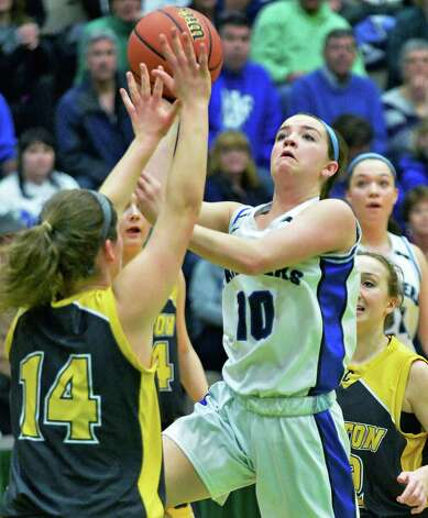 Hoosick Falls' #10 Rachel Pine, right, gets around Canton's #14 Natalie DiSalvo for two during the Class B girls' basketball regional final at HVCC Saturday March 14, 2015 in Troy, NY.  (John Carl D'Annibale / Times Union) Photo: John Carl D'Annibale / 00031026A
