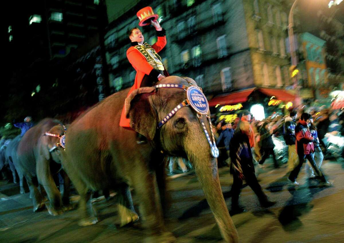 Elephants from the Ringling Bros. and Barnum & Bailey Circus walk through the streets of Manhattan on their way to Madison Square Garden in 2008. A reader commends the circus for its decision to phase out the iconic elephants from its performances by 2018.