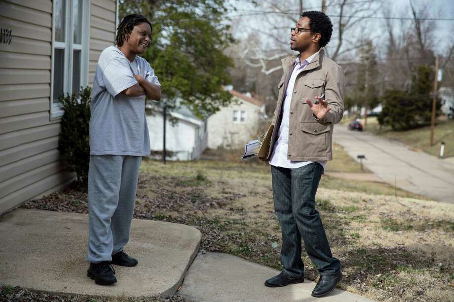 Wesley Bell, right, a City Council candidate for Ward 3, speaks with resident Vanessa Crawford as he canvasses a neighborhood Saturday in Ferguson, Mo. Photo: WHITNEY CURTIS, STR / NYTNS
