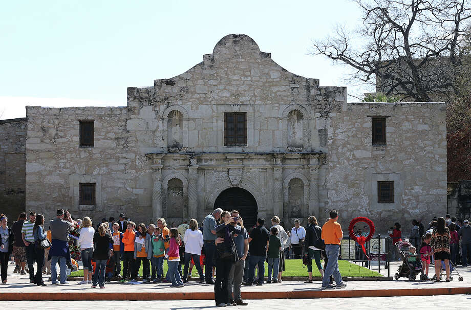 A spring break crowd gathers in front of the Alamo. Would voters approve money from the state's rainy day fund to pick up the tab for preservation? Photo: JERRY LARA, Staff / © 2015 San Antonio Express-News