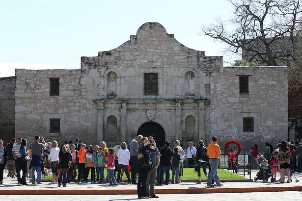 A spring break crowd gathers in front of the Alamo. Would voters approve money from the state's rainy day fund to pick up the tab for preservation?