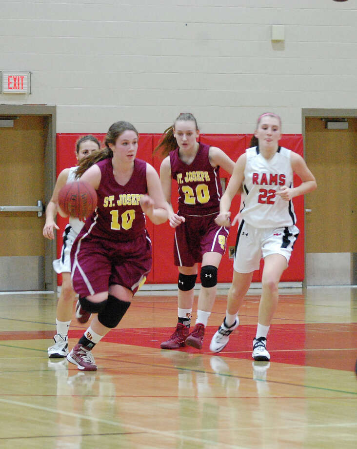 The Rams catch up to St. Joseph's Bridget Sharnick (#10) in transition during a girls basketball game in New Canaan Conn. on Monday, Feb. 17, 2014. Photo: Dave Crandall / New Canaan News freelance