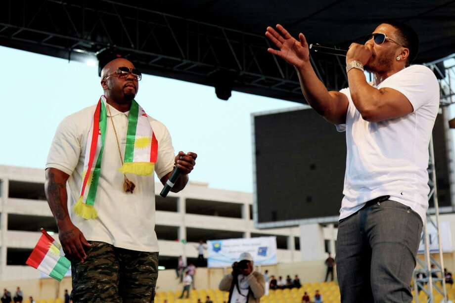U.S. rappers Nelly, right, and Ali, draped in a representation of the Kurdish flag, perform Friday in a concert in Irbil, northern Iraq, as part of an event to support Kurds fighting the Islamic State group. Photo: Seivan M. Salim, STR / AP