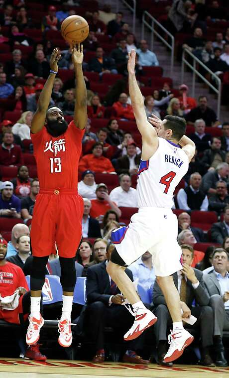 Rockets guard James Harden, left, hopes to rectify his inconsistent shooting against guard J.J. Redick, right, and the Clippers in a Los Angles matinee. Photo: James Nielsen, Staff / © 2015  Houston Chronicle