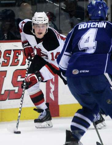 Albany Devils's #14 Reid Boucher, left, gets around Syracuse Crunch's #4 Jake Dotchin during Saturday's game at the Times Union Center  March 14, 2015 in Albany, NY.  (John Carl D'Annibale / Times Union) Photo: John Carl D'Annibale / 00030124L