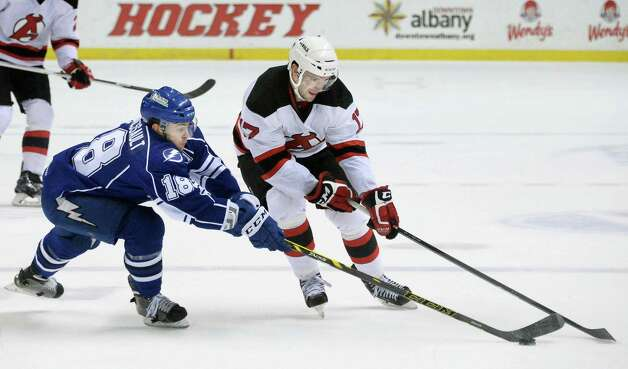 Syracuse Crunch's #8 Ryan Martindale, left, and Albany Devils's #17 Scott Timmins during Saturday's game at the Times Union Center  March 14, 2015 in Albany, NY.  (John Carl D'Annibale / Times Union) Photo: John Carl D'Annibale / 00030124L
