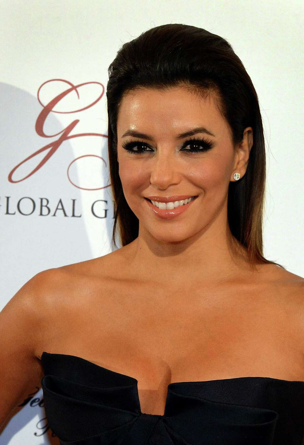 US actress Eva Longoria poses as she arrives to attend