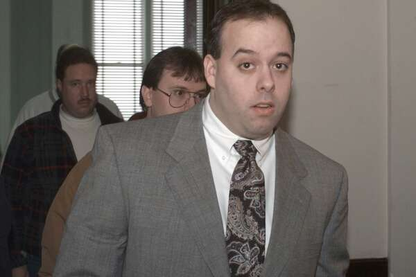 Albany police officer William Bonanni exits Albany County Court in Albany, Monday, March 22, 1999, in Albany, N.Y. (Michael P. Farrell)
