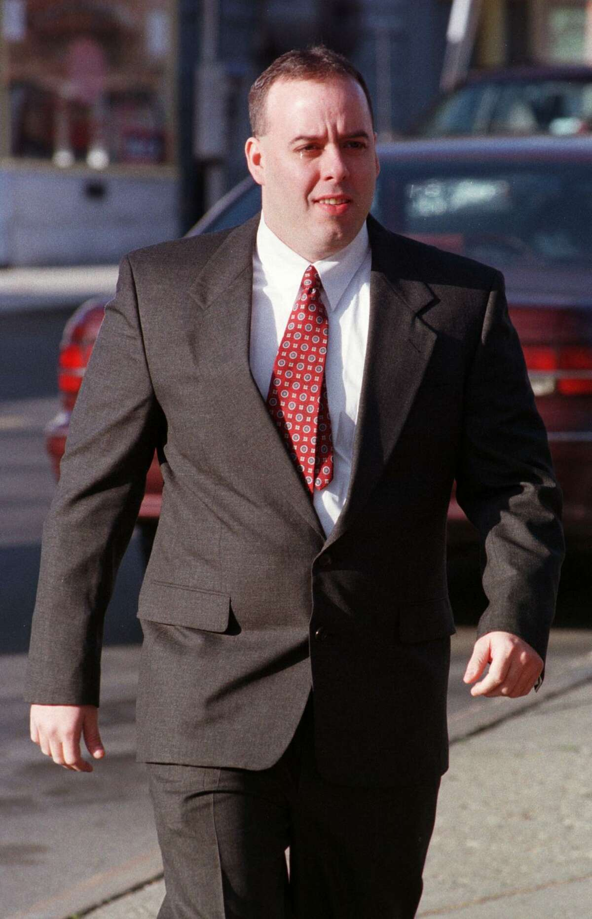 Albany police officer William Bonanni enters the public safety building, Nov. 14, 1998, in downtown Albany on the way to arraignment for alleged perjury charges in the Saint Rose hoop star beating case. (Skip Dickstein/Times Union)