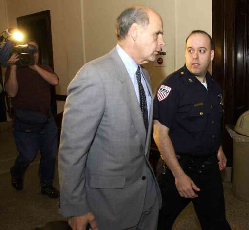 Attorney Stephen Coffey, center, walks with client, Albany Police officer, William Bonanni, right, as they head out of the Grand Jury room at the Albany County Courthouse Tuesday, May 4, 2004, in Albany, N.Y. (Paul Buckowski/Times Union archive) Photo: PAUL BUCKOWSKI / ALBANY TIMES UNION