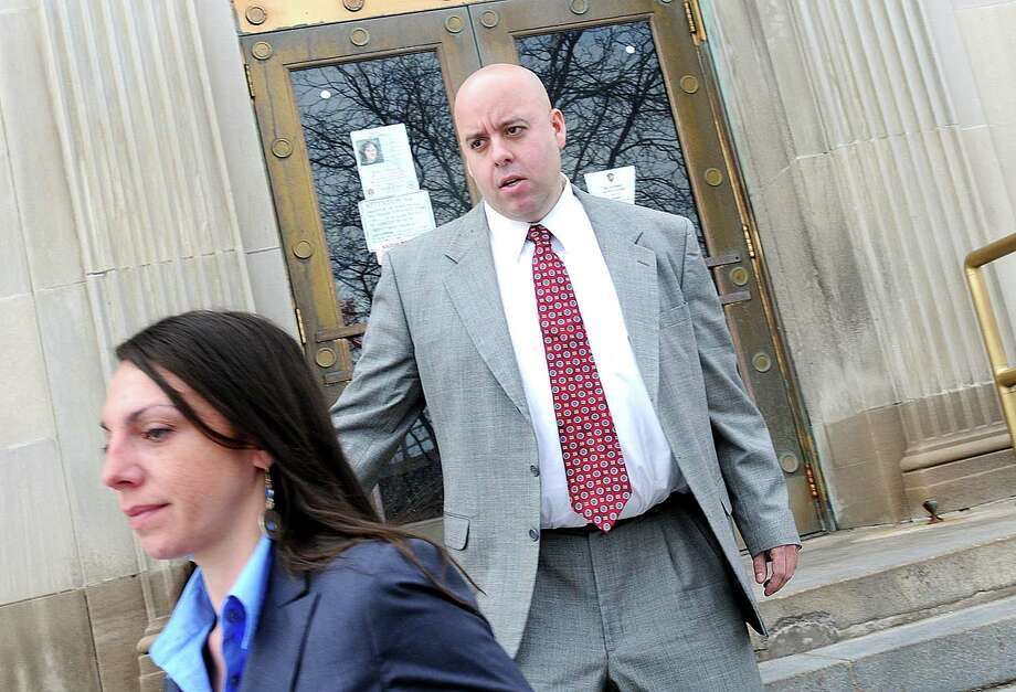 Albany Police Officer William Bonanni, center, leaves the courtroom at the Alexander Pirnie Federal Building for a hearing Thursday, March 6, 2008, in Utica, N.Y. (Steve Jacobs/Times Union archive) Photo: STEVE JACOBS / ALBANY TIMES UNION