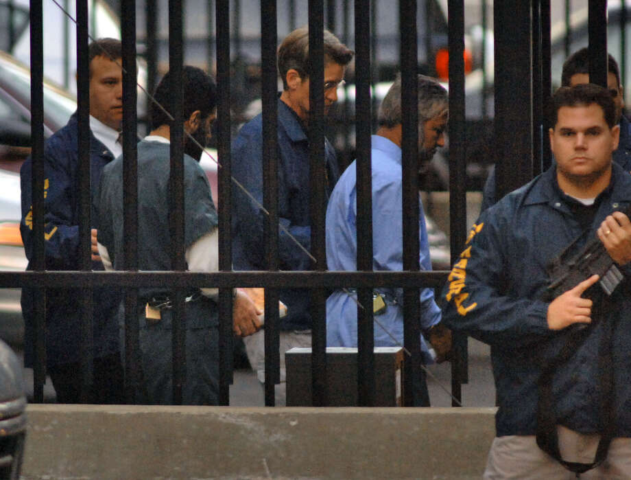 Yassin Muhiddin Aref, left, and Mohammed Hossain, right, are led away from the Federal Courthouse by U. S. Marshalls into a waiting van Tuesday evening October 10, 2006, in Albany, N.Y, following guilty verdicts in their trial. (Philip Kamrass/Times Union archive) Photo: PHILIP KAMRASS / ALBANY TIMES UNION