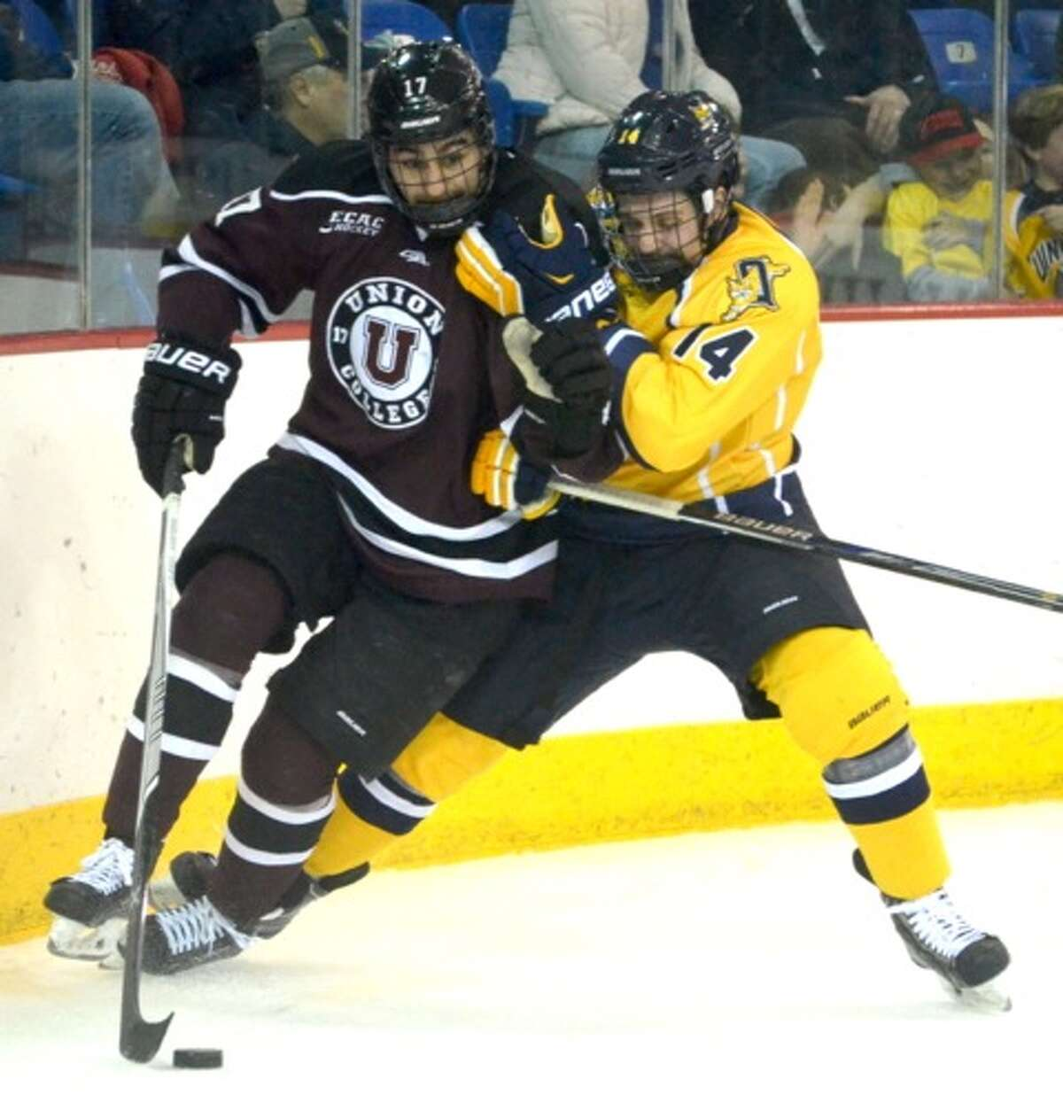 Union?s Derek Ciampini wards off Quinnipiac defensman Derek Smith in the second period of their ECAC quarterfinal on Saturday, March 14, 2015. (Nick Solari / Special to the Times Union)