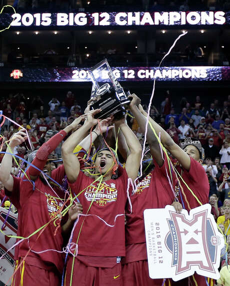 Iowa State players show off their hardware after defeating top-seeded Kansas 70-66 in the Big 12 championship game Saturday at Kansas City, Mo. It was the Cyclones' second consecutive conference tournament title. Photo: Charlie Riedel, STF / AP