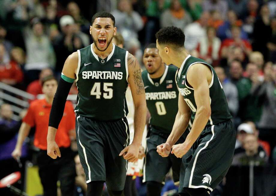 Michigan State's Denzel Valentine (45), Marvin Clark Jr. (0) and Travis Trice had a lot to celebrate after upsetting No. 8 Maryland in the Big Ten tournament. Photo: Nam Y. Huh, STF / AP