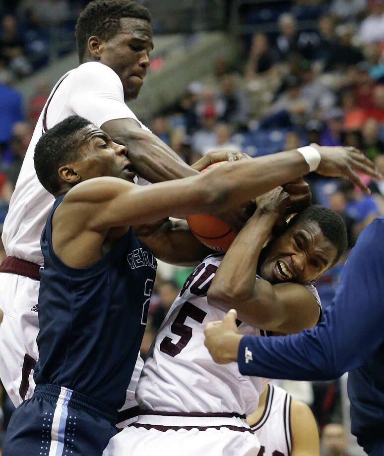 Raider center Curglon Wesley is overpowered on the offensive rebound by Devonte Patterson (top and Keenan Holdman (5) as Houston Sterling plays Bridgeport in the 4A finals of the UIL state basketball tournament at the Alamodome in San Antonio on March 14, 2015. Photo: Tom Reel