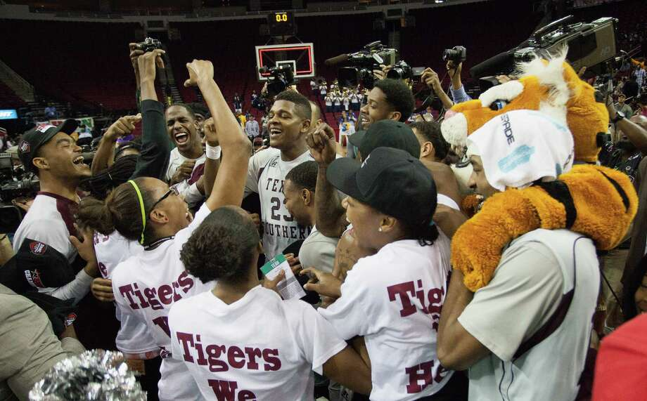 Texas Southern players and followers exhibit their Tiger pride after TSU won the SWAC tournament title Saturday night at Toyota Center. The Tigers eked out a 62-58 victory over Southern. Photo: Bob Levey, For The Chronicle / ©2015  Bob Levey