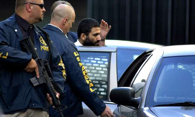 Yassin M. Aref, center, is lead to a waiting vehicle by U.S. Marshals after being taken into custody for terrorism-related counts following a hearing at the Federal Court House Friday Sept. 30, 2005, in Albany, N.Y.  (Michael P. Farrell/Times Union archive) Photo: MICHAEL P. FARRELL / DG