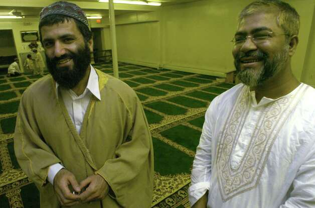 Iman Yassim Muhiddin Aref, left, and Mohammed Hossain, right, are pictured during a mid-day prayer at the Masjid Al Salam Mosque on Central Ave. Thursday, Sept. 2, 2004, in Albany, N.Y.  (Michael P. Farrell/Times Union archive) Photo: Staff Photographer / DG