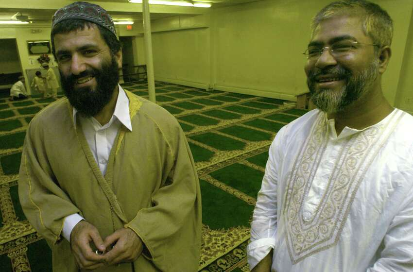 Iman Yassim Muhiddin Aref, left, and Mohammed Hossain, right, are pictured during a mid-day prayer at the Masjid Al Salam Mosque on Central Ave. Thursday, Sept. 2, 2004, in Albany, N.Y. (Michael P. Farrell/Times Union archive)