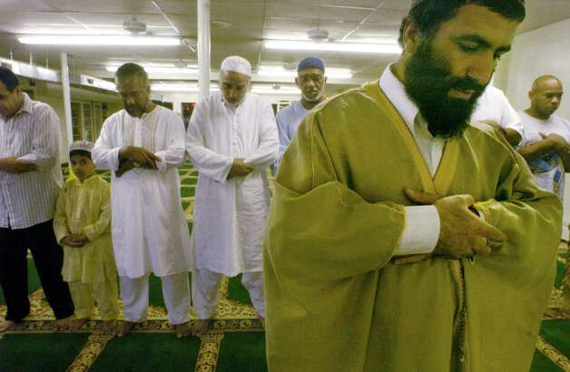 Yassim Muhiddin Aref, front right, and Mohammed Hossain, third from left, with his eight-year-old son Horyra, worship during a mid-day prayer at the Masjid As-Salam Mosque on Central Ave. Thursday, Sept. 2, 2004, in Albany, N.Y.  (Michael P. Farrell/Times Union archive) Photo: Michael P. Farrell / TIMES UNION MICHAEL P. FARRELL