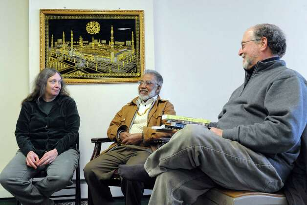 Masjid As-Salaam Mosque president Ahmad Shamshad , center, with the attorneys for Yassin Muhiddin Aref, Kathy Manley, left, and Steve Downs at the Central Avenue mosque on Friday Feb. 13, 2015 in Albany, N.Y. (Michael P. Farrell/Times Union) Photo: Michael P. Farrell / 00030604A