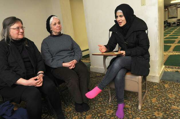 As Jeanne Finley, left, and Lynne Jackson listen Yassin Aref's daughter, Salah Muhiddin, right, talks about her memories of her father at the Masjid As Salam mosque on Tuesday, March 3, 2015, in Albany, N.Y.  (Michael P. Farrell/Times Union) Photo: Michael P. Farrell / 00030830A