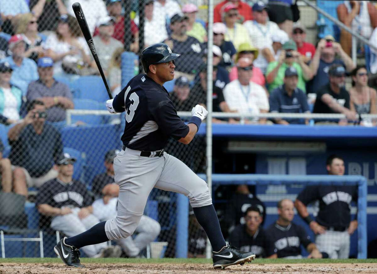 New York Yankees' Alex Rodriguez hits a single in the fourth inning of a spring training baseball game against the Toronto Blue Jays in Dunedin, Fla., Saturday, March 14, 2015. (AP Photo/Kathy Willens) ORG XMIT: FLKW103