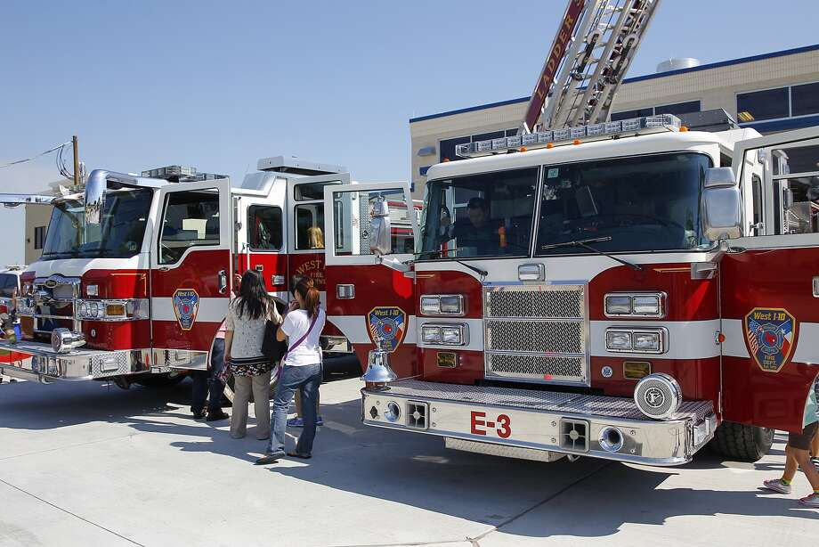 Fire trucks were open to young and old alike at the new West I-10 Fire Station Number 3, located at Westgreen and Highland Knolls, during its open house to the public on October 19, 2014. Photo: Diana L. Porter, Freelance / © Diana L. Porter