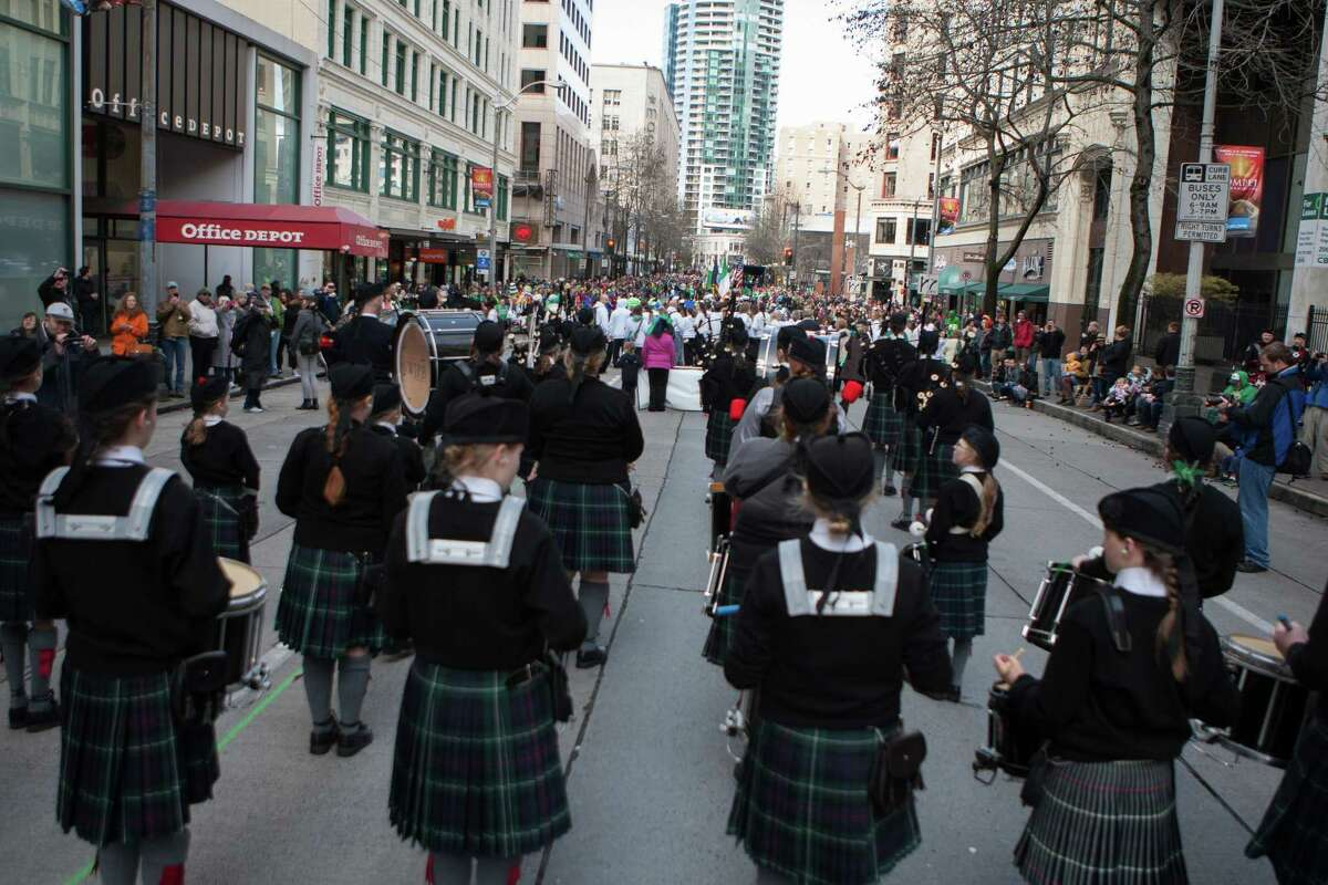 The Northwest Junior Pipe Band marches down 4th Ave. for the annual St. Patrick's Day Parade in downtown Seattle. Photographed on Saturday, March 14, 2015.