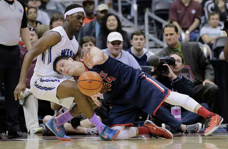 Plano West's Soso Jamabo, left, and Houston Clear Lake's Chris Stenerson (34) struggle for the ball during a UIL boys' 6A basketball state finals game, Saturday, March 14, 2015, in San Antonio. (AP Photo/Eric Gay) Photo: Eric Gay, STF / AP