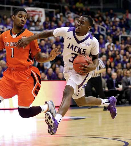 Stephen F. Austin's Jared Johnson, right, scored 17 points to help the Lumberjacks beat Sam Houston State and earn an NCAA Tournament bid. Photo: David J. Phillip, STF / AP
