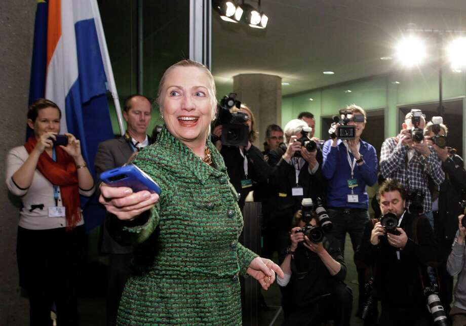 The email controversy swirling around Hillary Clinton is a reminder that a party nomination will mean supporters in constant defense mode because no Clinton ever seems to be vetted enough. Surprises keep coming. Then-U.S. Secretary of State Hillary Rodham Clinton hands off her mobile phone in 2011 after arriving to meet with Dutch Foreign Minister Uri Rosenthal at the Ministry of Foreign Affairs in The Hague, Netherlands. Photo: J. Scott Applewhite /Associated Press / AP