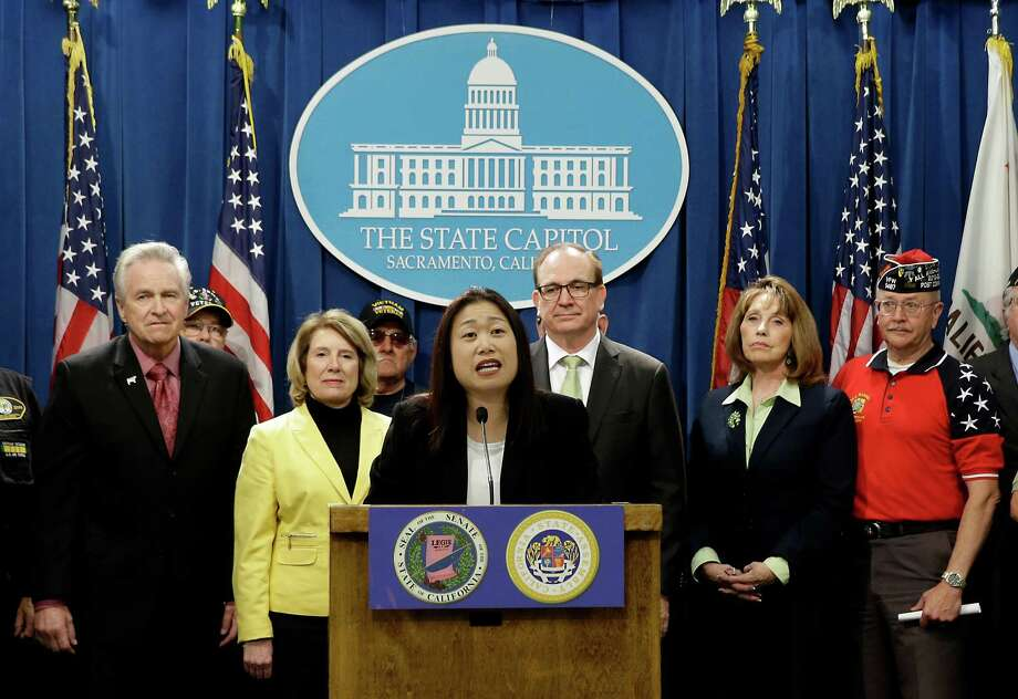 Accompanied by fellow GOP lawmakers and veterans, State Sen. Janet Nguyen, R-Garden Grove, center, announces a proposed constitutional amendment to block publicly funded universities from banning the American flag, at a news conference in Sacramento, Calif.,on Monday. The proposal comes after a student council at the University of California, Irvine last week, banned the display of a flag in its lobby. Photo: Rich Pedroncelli /Associated Press / AP