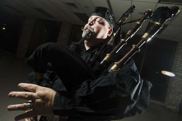 Jeff Courts plays the bagpipes at St. Stephen's Episcopal Church on Monday night. Courts, a self-taught bagpiper, has been playing the pipes with the Lone Star Bagpipe Band for 25 years. Photo taken Monday 3/2/15 Jake Daniels/The Enterprise