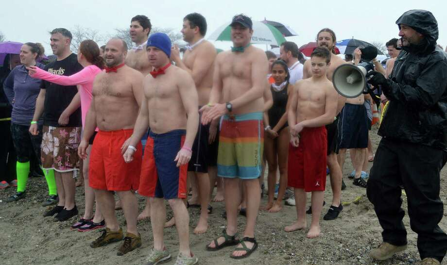 Participants in the Penguin Plunge, benefiting the Special Olympics, line up for a chilling dip at Compo Beach on Saturday. Photo: Jarret Liotta / Westport News