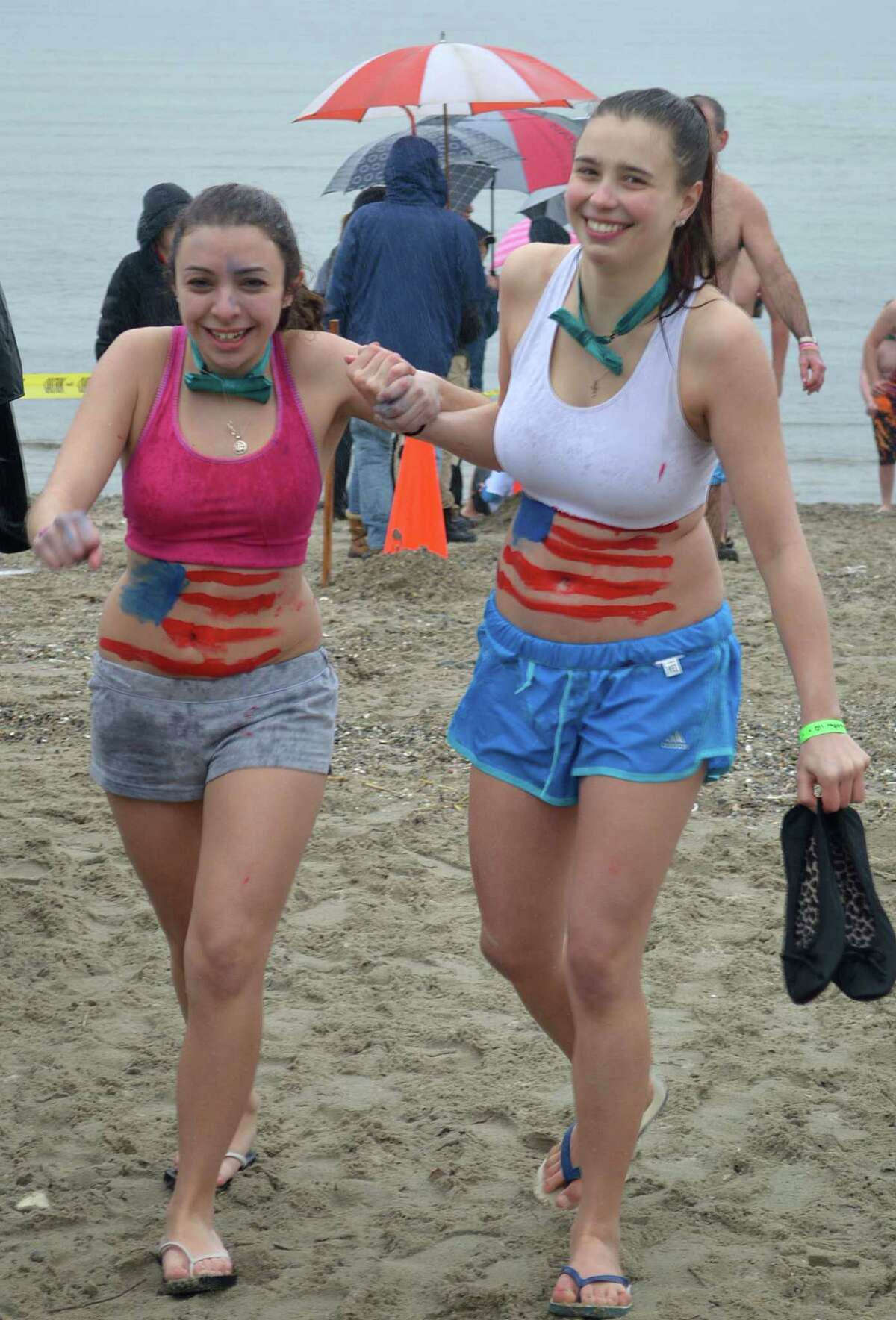 Victoria Lettiero, left, and her friend Julia Gonifiantiti, came from Sacred Heart University to Compo Beach for the Penguin Plunge benefiting the Special Olympics.