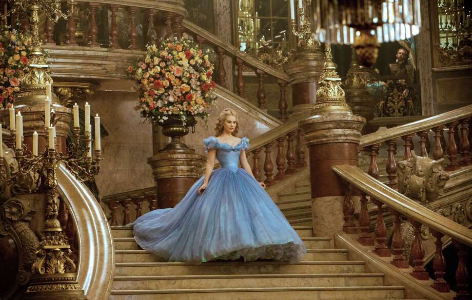 "This image released by Disney shows Lily James as Cinderella in Disney's live-action feature film inspired by the classic fairy tale, ""Cinderella."" Photo: Jonathan Olley, AP / Disney"