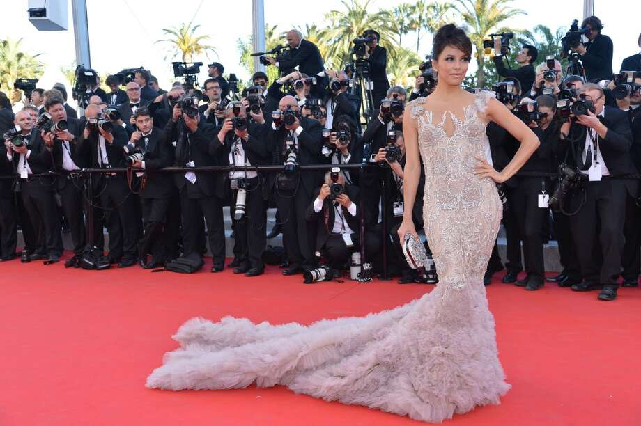 """US actress Eva Longoria arrives for the screening of """"Moonrise Kingdom"""" and the opening ceremony of the 65th Cannes film festival on May 16, 2012 in Cannes.    AFP PHOTO / ALBERTO PIZZOLI        (Photo credit should read ALBERTO PIZZOLI/AFP/GettyImages) Photo: ALBERTO PIZZOLI, AFP/Getty Images"""