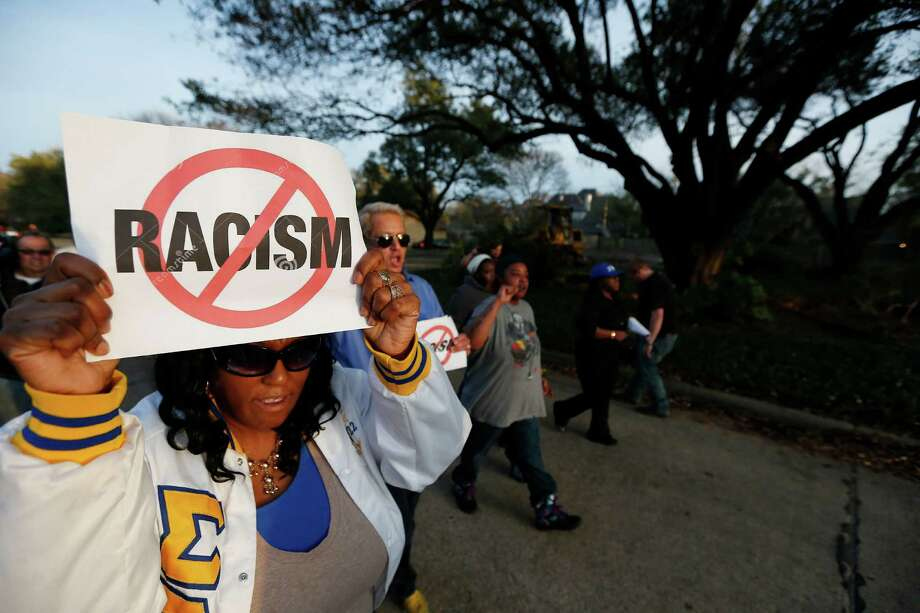 Darmita White and about two-dozen others protests outside the family home of a former University of Oklahoma Sigma Alpha Epsilon fraternity member Parker Rice, who along with several other fraternity members was seen on video chanting a racist song. Photo: Brandon Wade /Associated Press / FR168019 AP