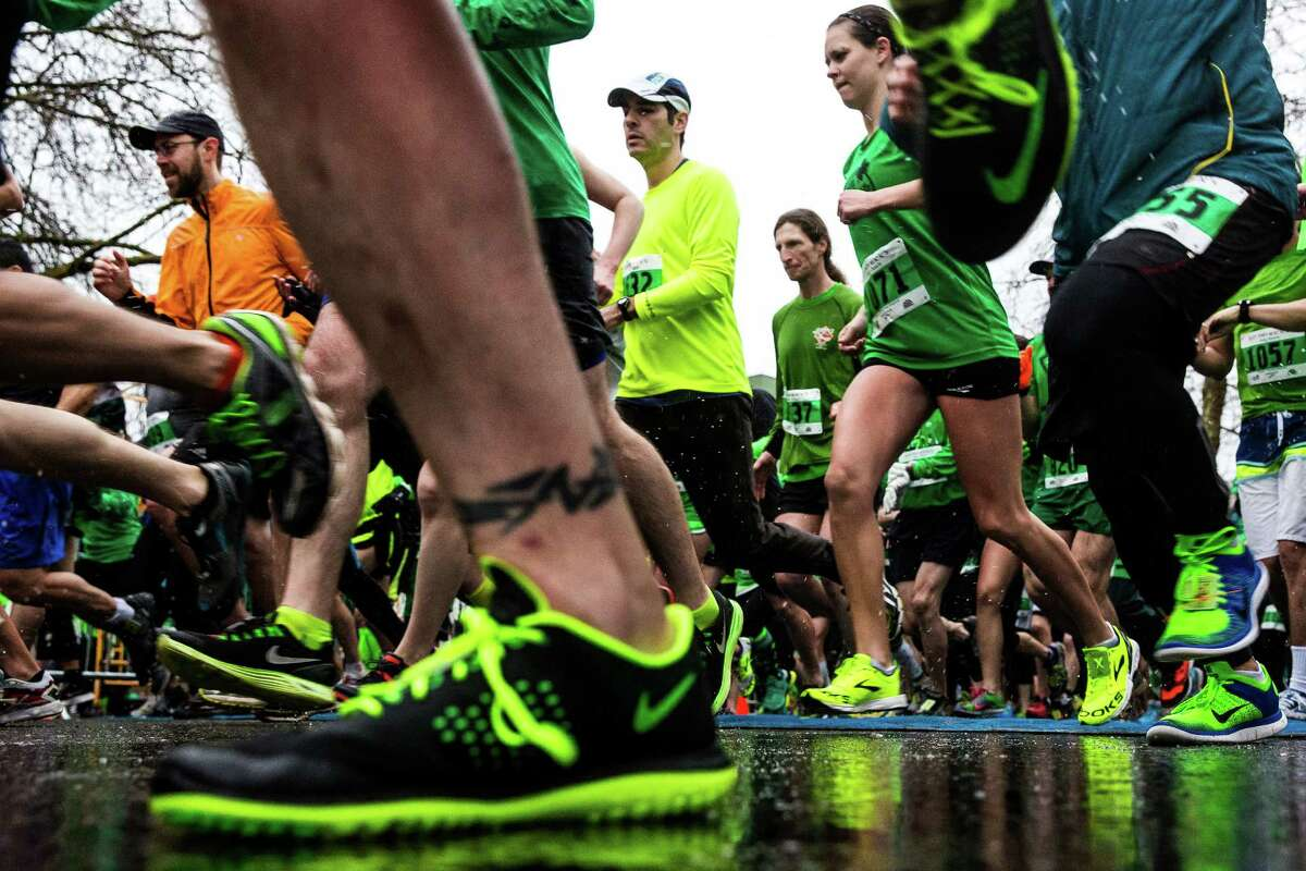 The annual St. Patrick's Day Dash attracted thousands of enthusiastic, green-clad runners to brave pouring rain for the sake of fun Sunday, March 15, 2015, in Seattle, Washington. The event benefits the Detlef Schrempf Foundation.