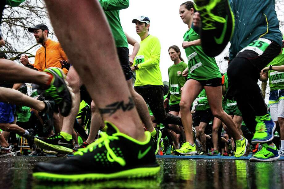 The annual St. Patrick's Day Dash attracted thousands of enthusiastic, green-clad runners to brave pouring rain for the sake of fun Sunday, March 15, 2015, in Seattle, Washington. The event benefits the Detlef Schrempf Foundation. Photo: JORDAN STEAD, SEATTLEPI.COM / SEATTLEPI.COM