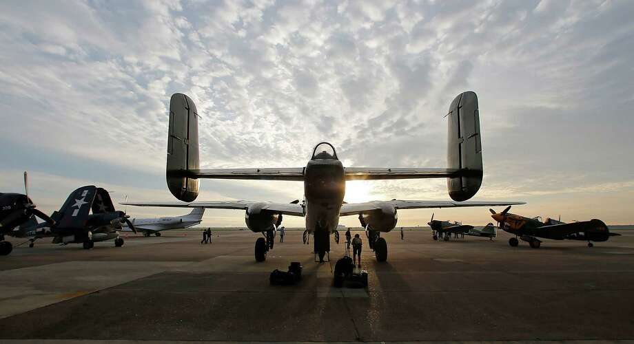 "A B25 Mitchell Bomber ""Betty's Dream"" sits idle while awaiting the Texas Legends Museum WWII Warbirds departure from Ellington Field for a 2,200 mile international mission to perform in Saint-Barthelemy James Nielsen / Houston Chronicle. Sunday, March 15, 2015, in Houston. The five planes from the museum will perform at the 2015 St. Barth's Bucket Regatta. Photo: James Nielsen, Houston Chronicle / © 2015  Houston Chronicle"
