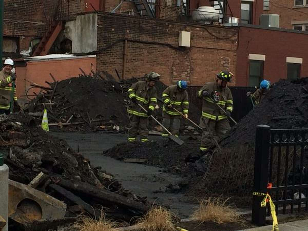 Members of the federal Bureau of Alcohol, Tobacco, Firearms and Explosives and local fire officials sift through debris March 15, 2015 looking for a possible cause, and perhaps more victims, from a March 6 fatal fire on Jay Street in Schenectady. (Photo by Lauren Stanforth)