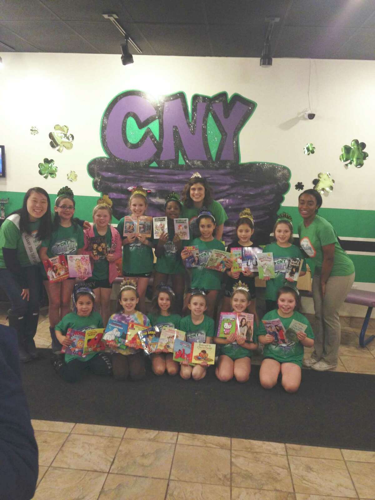 CNY Storm All Star in Albany hosted a book drive by one of its cheer teams, Breeze. The girls set up boxes and collected books that were donated to the Albany Tulip Queen, Caitlin Whelan, and her court for their literacy campaign. A grand total of 532 books were collected in a few short weeks. (Tara Hulett)