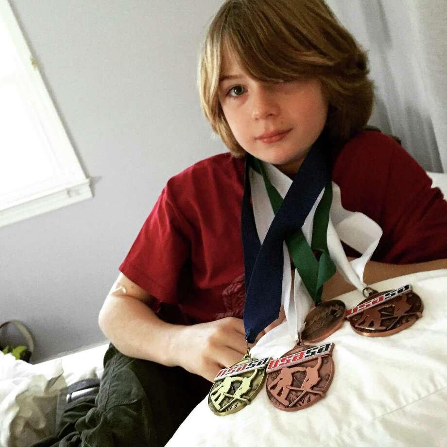 Sumner Orr poses with his medals from this year. Photo: Michelle Orr/Contributed Photo, Contributed Photo / New Canaan News