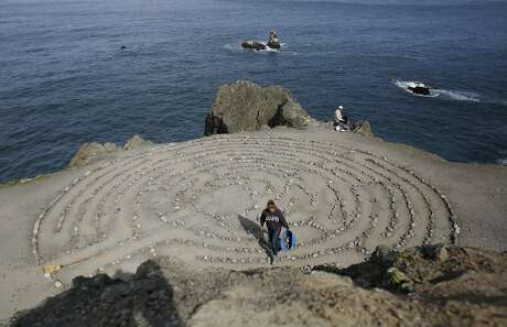 After being away on vacation, Colleen Yerge, known as the keeper of the Lands End Labyrinth, fixes up the labyrinth in San Francisco, Calif.