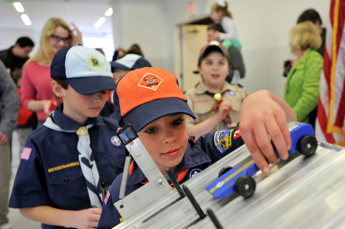 Jack Sepot with Pack 33 places his pinewood car on the starting blocks before the start of one of his races during the 2015 Greenwich Council Cub Scout Pinewood Derby Championship at Miller Motorcars in Greenwich, Conn., on Sunday, March 15, 2015. The top three racers from each Cub Sout pack of Greenwich's 10 packs competed Sunday for the top spot town-wide.