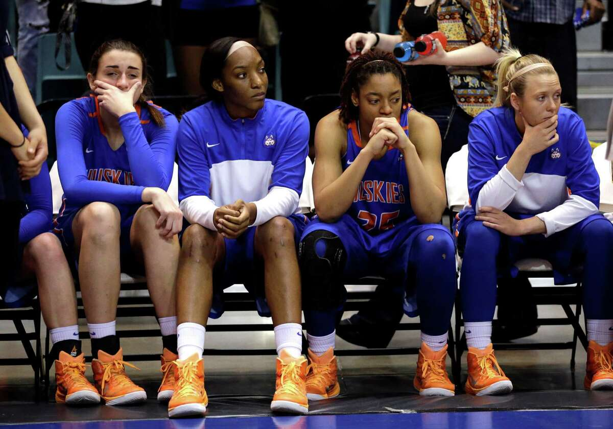 Houston Baptist players sit on the bench as Northwestern State players celebrate after an NCAA college basketball game in the championship of the Southland Conference tournament Sunday, March 15, 2015, in Katy, Texas. Northwestern State won 58-50. (AP Photo/David J. Phillip)